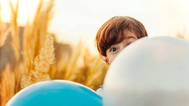 Child Behind Balloons Childhood Emotional Neglect